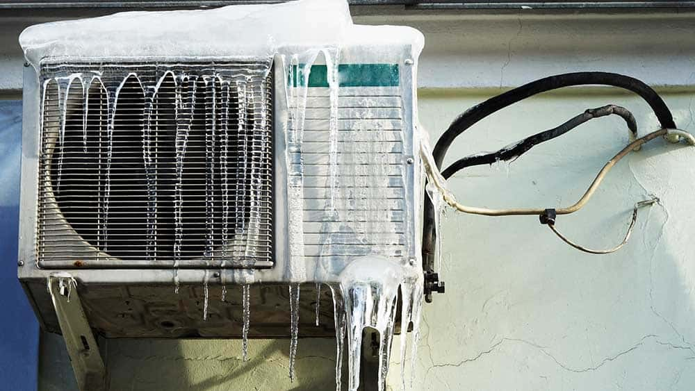 Damaged AC due to ice in winter.
