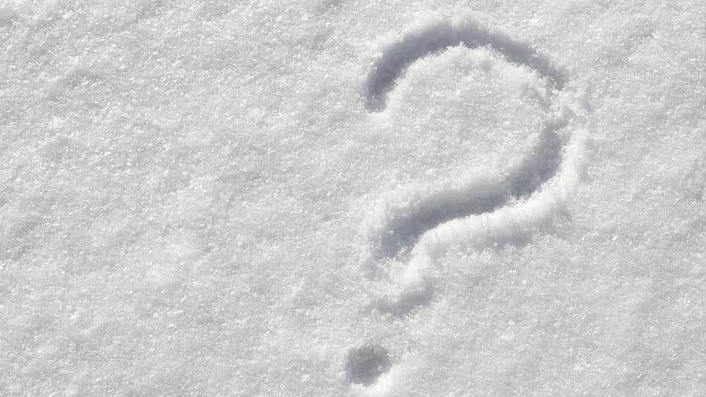 Running AC in winter, is it safe or not? Question mark in the snow.