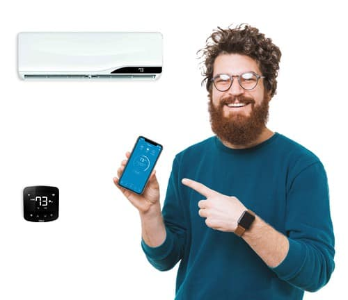A happy boy controlling his air conditioner with Cielo Home mobile application.