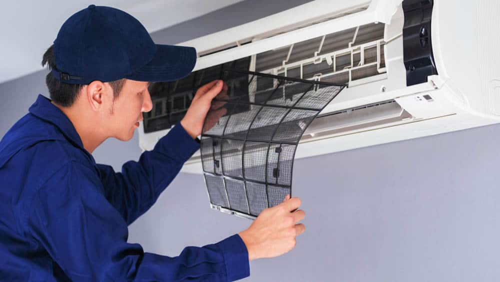 Technician replacing filter of Air conditioner.