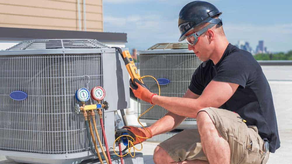 Man checking refrigerant of HVAC system.