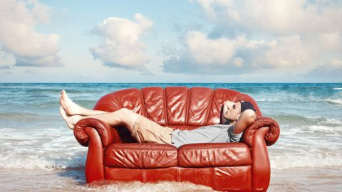Man relaxing on sofa - How to stay cool without AC