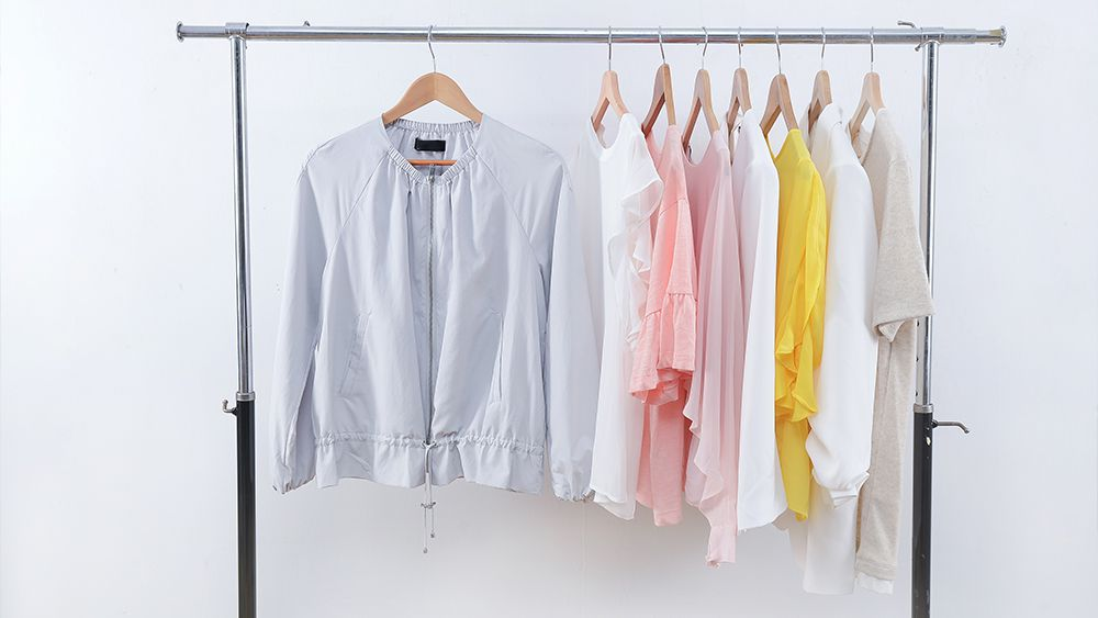 Summer closet consisting of light colored clothes