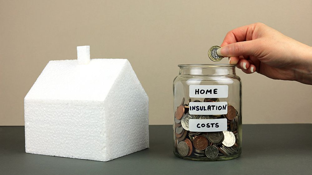 A jar full of coins wit a label, 'home insualtion cost'