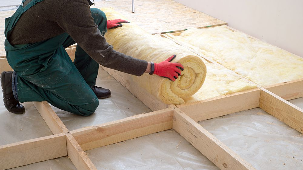 A man is insulating the floor