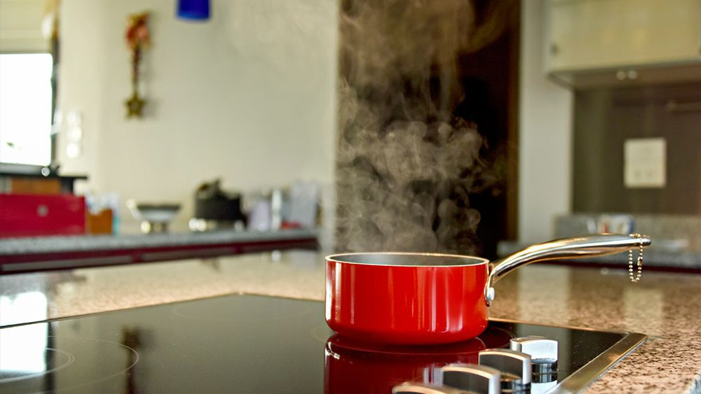 Red pan on a stove