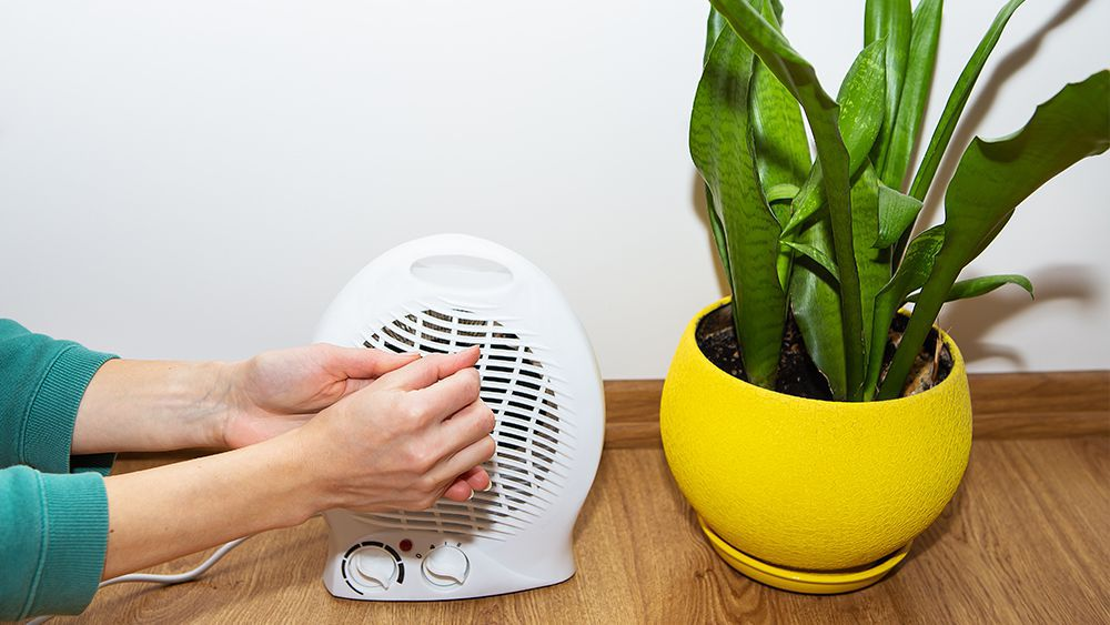 A woman using space heater